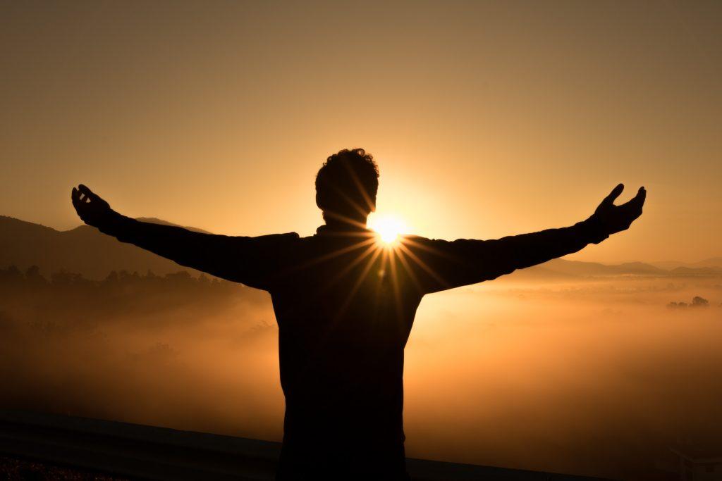 Man hailing the sun